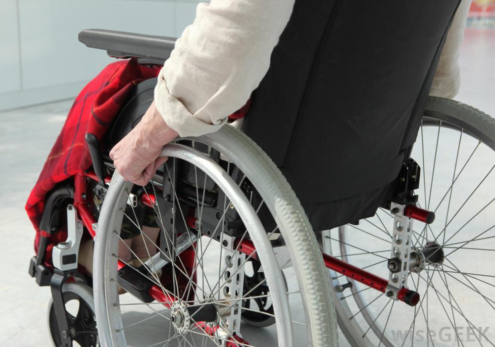 man-pushing-wheelchairjpg